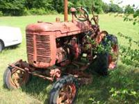 40's model tractor. Runs good and mower attachment