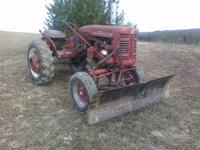 Farmall 100, this tractor runs well and will not