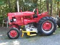 Farmall A tractor in great condition. Has new paint,