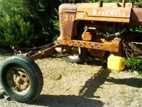Farmall tractor. wide front end with plow disk. Runs