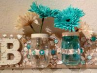 Several different styles of mason jar hangings for