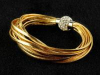 Brand New never worn Fashion jewelry:  Gold Leather