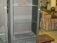 This is a faux slate book case with 2 glass shelves,