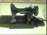 This singer featherweight sewing machine was