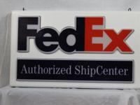 FEDEX METAL DOUBLE SIDED LIT HANGING SIGN. THE SIGN IS