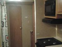 Fema trailer with bunks and queen bed in front. Has had