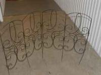 Decorative metal fencing pieces that hook together.