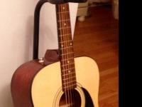 Barely used Fender Acoustic Guitar, comes with black
