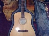 Fender Acoustic guitar in natural wood color. Looks