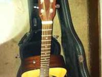 This a fender acoustic guitar with hard case and brand