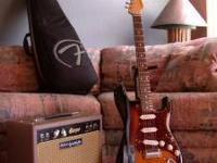2 yrs. old perfect condition John Mayer Strat. Very