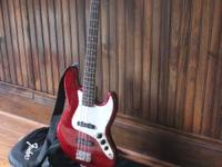 Like New Fender Bass Guitar with carry case and playing