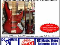 A used Fender electricity bass guitar. Guitar seems and