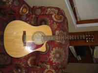 Am offering an almost new Fender Acoustic 6-string