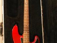 This listing is for a Fender Candy Apple Red Squier
