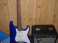 blue Fender Stratocaster (Squier series) and Squier amp