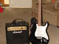 Fender guitar with stand and a marshall amp...Sounds