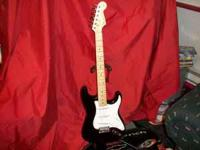selling 2 fender stratocasters with new Gigbag cases.