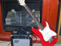 This is a smaller scale guitar and amplifier that plays
