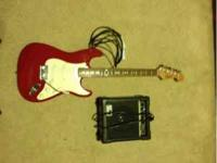 A nice Fender guitar and Venom amp. The guitar has some