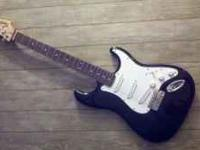 I am selling a Fender Squire Strat electric guitar as