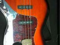 This is a fender squire jazz bass has a sweet sound. No