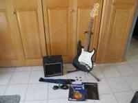Fender Strat Squire guitar with a Roland amp. This is a
