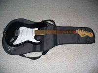 This is a Used Fender Stratocaster Squire, It has one