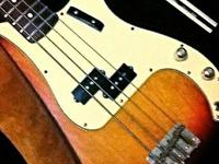 I have a 2004 USA Fender Precision Bass. It's sunburst