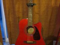 I am offering an utilized Fender DG22CE Red cutaway