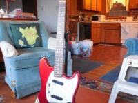 Fender Mustang guitar is in excellent used condition.