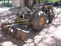 FERGUSON TRACTOR WITH LOADER, SCRAPER BLADE AND PLOW.