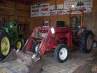 Tractor has a Massey Ferguson Loader and Roll Bar. Rear