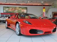 Here is a 2009 430 F1 Spider in Rosso Corsa with Beige