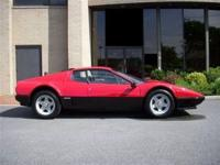 This 1982 Ferrari 512 BBi 2dr Red Black Coupe . It is