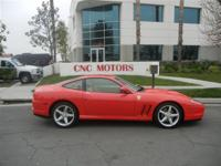 CNC MOTORS OFFERS THIS FERRARI 575 RED TAN WITH LOW