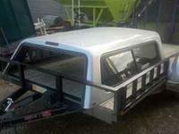 For sale is a silver in color fiberglass topper. Was