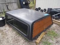 Black fiberglass truck mattress topper off of 2004