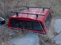 For sale is a red fiberglass truck cap that came off a