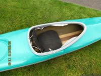 Fiberglass Kayak roughly around 16 feet. Great for