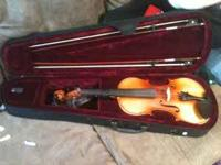 like new violin, comes with two bows. violin, rosin,