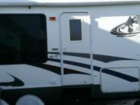 Excellent Condition; Model 285K; Rear Kitchen; 1 Slide