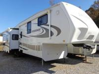 BEAUTIFUL 5TH WHEEL FOLKS! THIS UNIT HAS: POWER AWNING