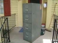 "Four drawer metal filing cabinet - 53"" H x 15"" W x 28"""