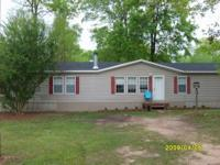 $70,000 This manufactured home sits on a beautiful lot