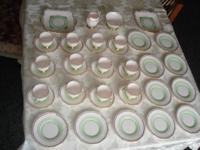 "Full tea service for 12, cups 3"" w x 3"" d. dishes 5"""