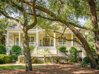 Set under a canopy of ancient moss-covered oaks and