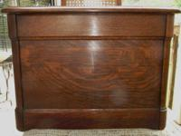 This is an oak commode that would have been used in a