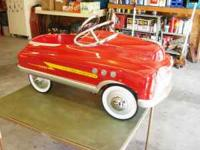 I have for sale, a beautiful! Red Fire Chief Pedal Car.