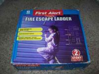 Brand new never opened 2 story fire escape ladder,